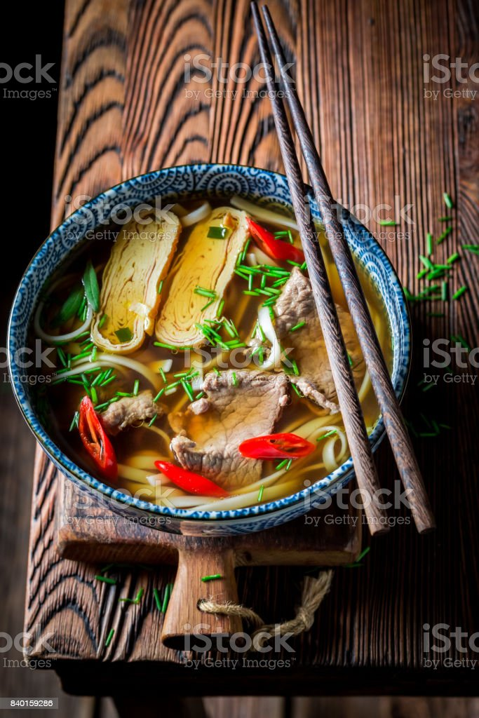 Closeup of delicious Red Curry soup with beef and noodle stock photo