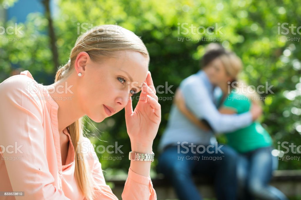 Close-up Of Depressed Young Woman stock photo