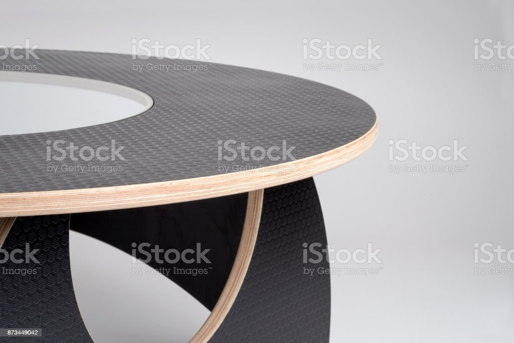 Closeup of Designer Wooden Round Table in Black Rubber Finish stock photo