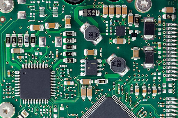 closeup of details on a circuit board - mother board stock photos and pictures