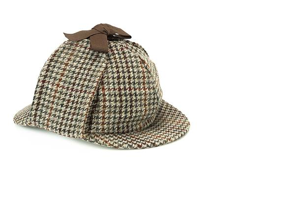close-up of detective deerstalker cap isolated - sherlock holmes stock photos and pictures