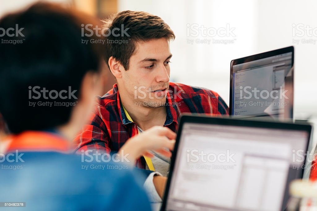 Close-up of Development Team In Their Office. stock photo