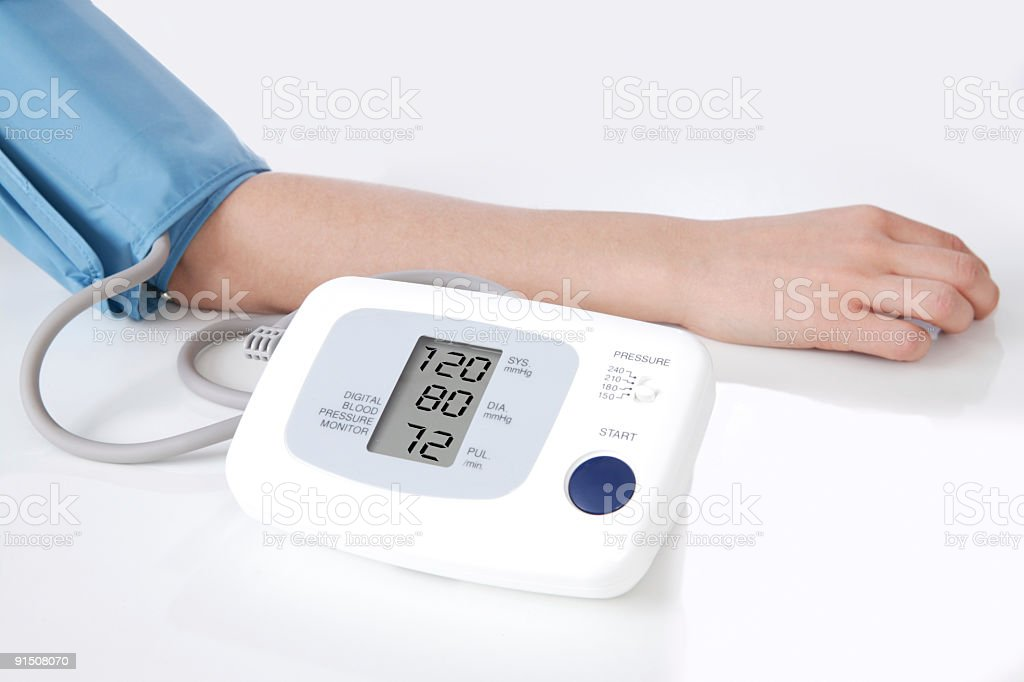 Close-up of digital blood pressure meter attached to arm stock photo