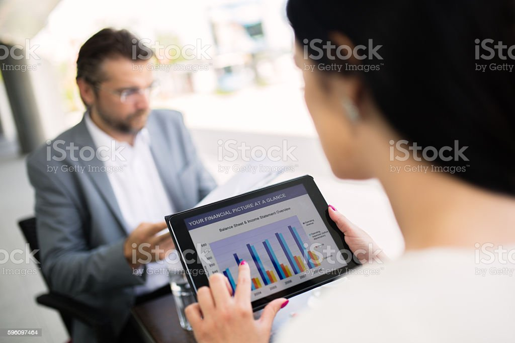 Close-up of digital tablet with finance report. stock photo