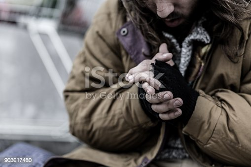 istock Close-up of dirty beggar's hands 903617480