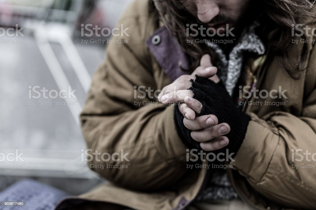 Close-up of dirty beggar's hands stock photo