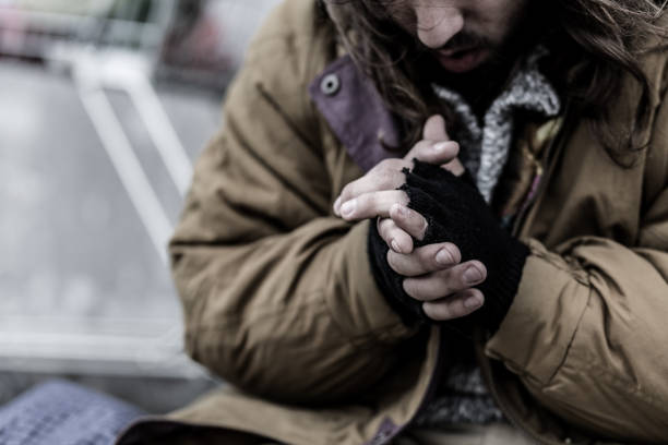 close-up of dirty beggar's hands - homelessness stock photos and pictures