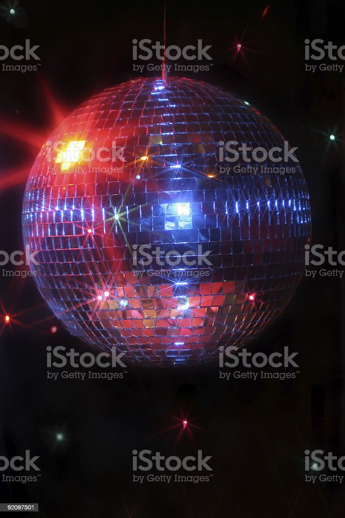 Closeup of disco ball with light reflections on black back stock photo