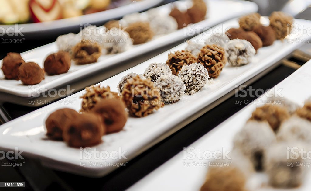 Close-up of dishes filled with chocolate truffles royalty-free stock photo
