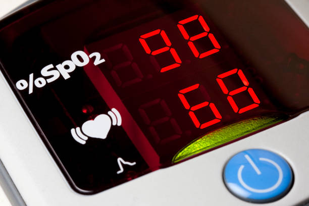 Closeup of display of pulse oximeter to measure pulse rate and blood oxygen saturation stock photo