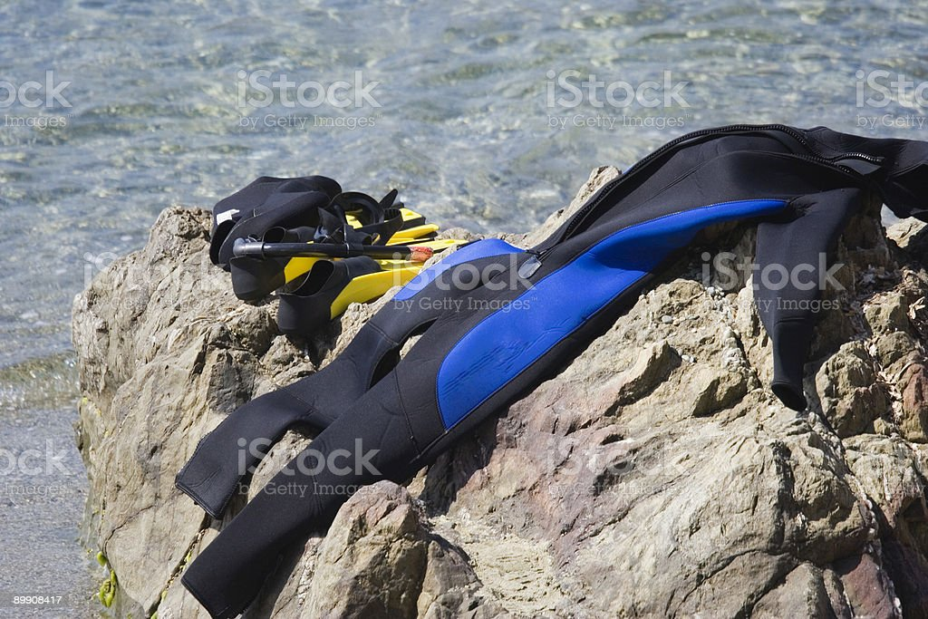 close-up of diving gear on a rock royalty-free stock photo
