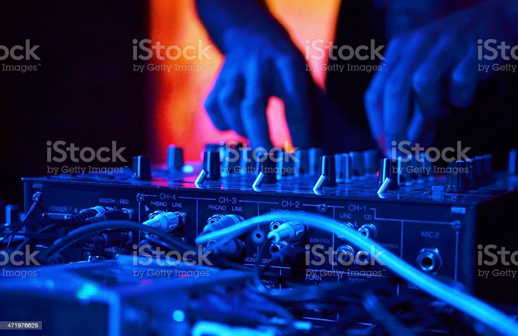 Close-up of DJ's hands working on the mixer equipment royalty-free stock photo