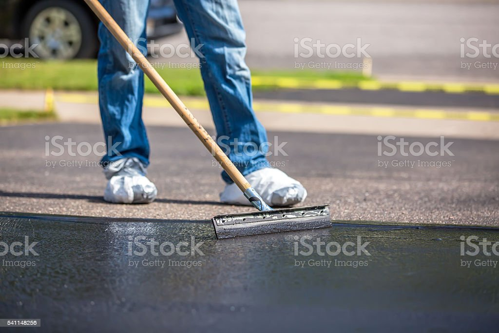 Closeup of do it yourself driveway seal coating stock photo close up of do it yourself driveway seal coating royalty free stock photo solutioingenieria Choice Image