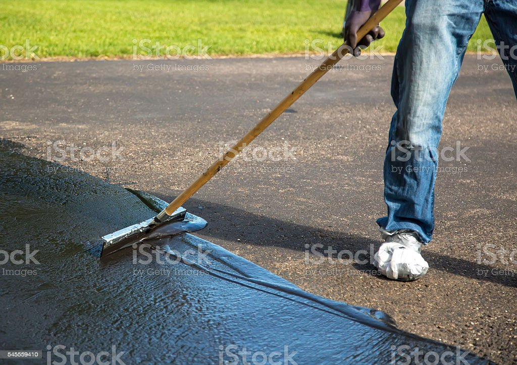 Closeup of do it yourself driveway seal coating stock photo more close up of do it yourself driveway seal coating royalty free stock photo solutioingenieria Images