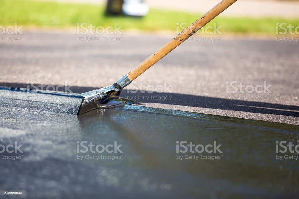 Closeup of do it yourself driveway seal coating stock photo more close up of do it yourself driveway seal coating royalty free stock photo solutioingenieria Choice Image