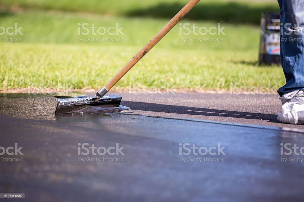 Close-Up of Do It Yourself Driveway Seal Coating stock photo