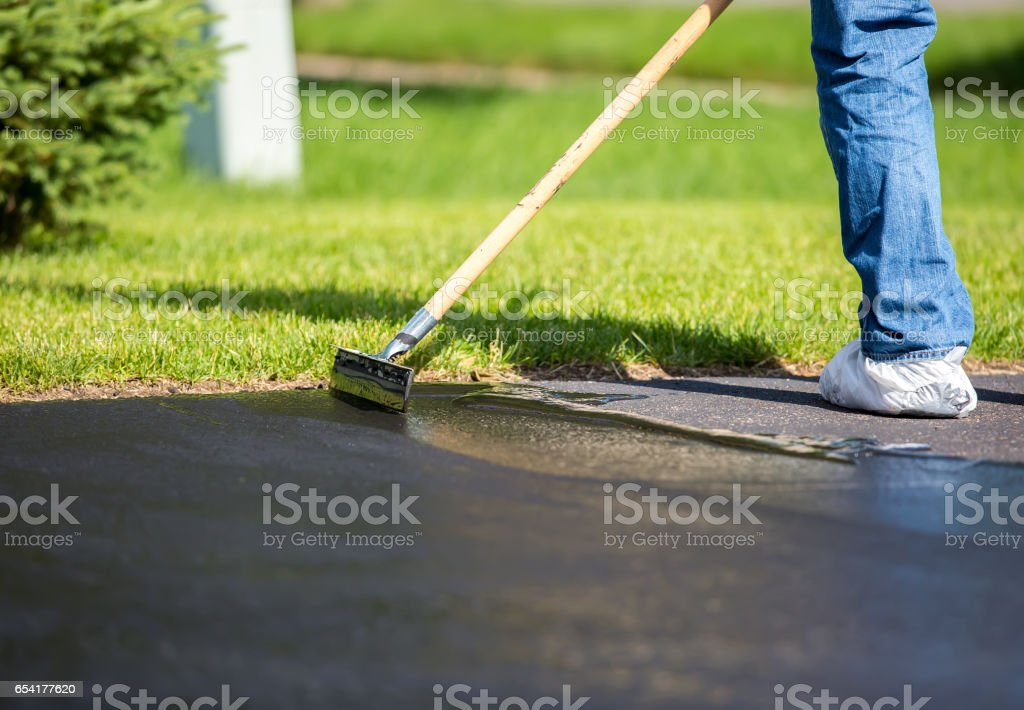 Closeup of do it yourself driveway seal coating stock photo more close up of do it yourself driveway seal coating royalty free stock photo solutioingenieria Gallery