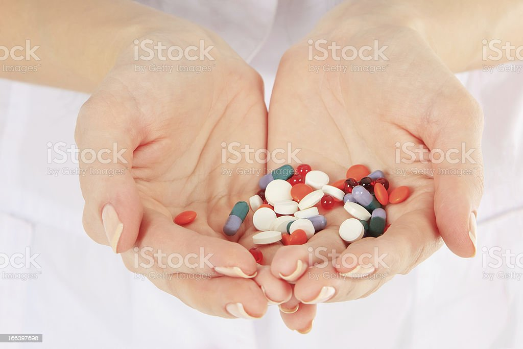 Close-up of doctor holding a pills in the hands royalty-free stock photo