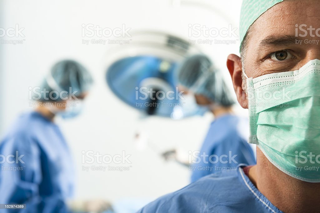 Close-up of doctor wearing blue surgical mask stock photo