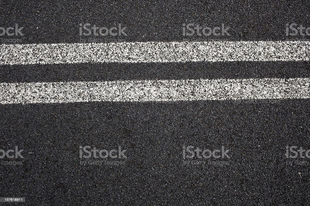 Close-up of double white lines on pavement stock photo