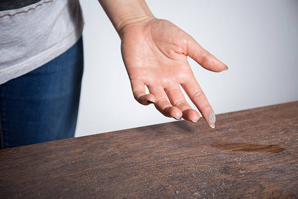 Close-up of dust on woman finger stock photo