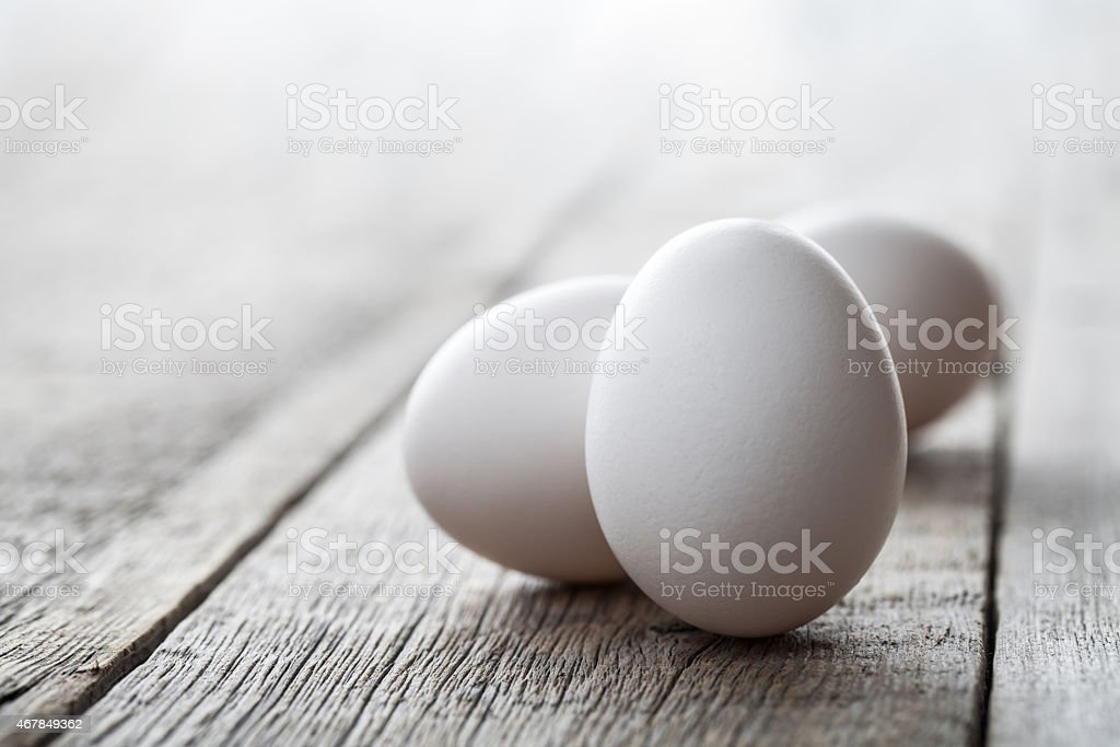 Close-up of eggs on wooden table stock photo