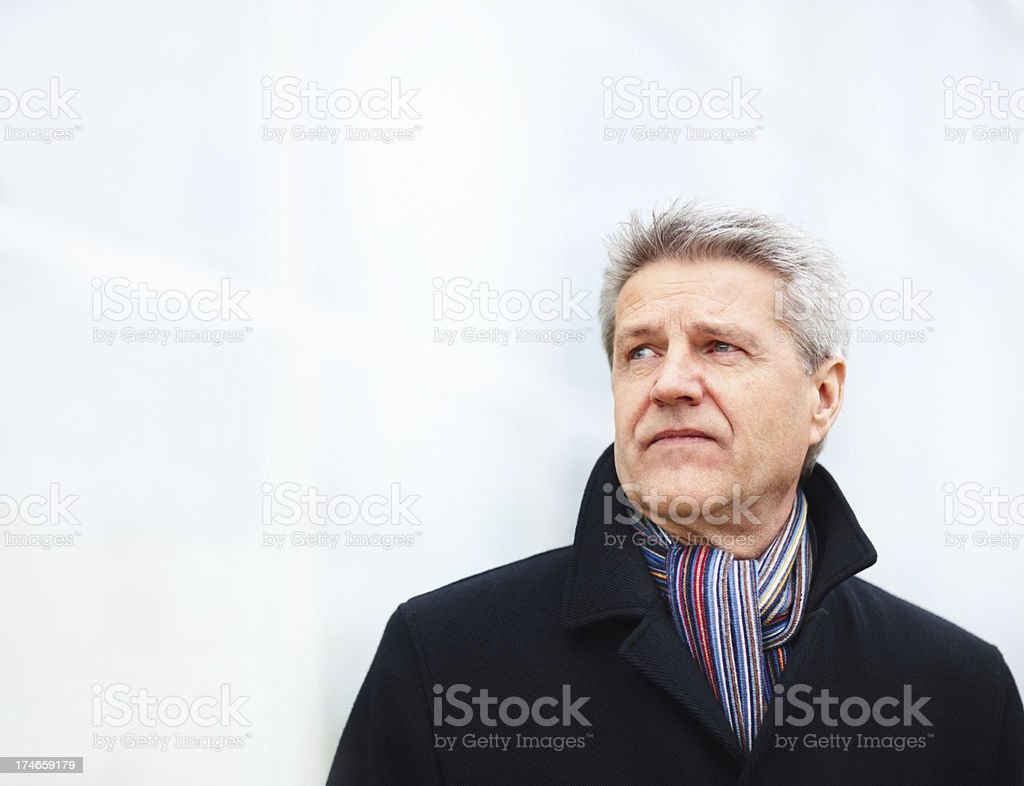 Close-up of elderly man looking away and thinking royalty-free stock photo