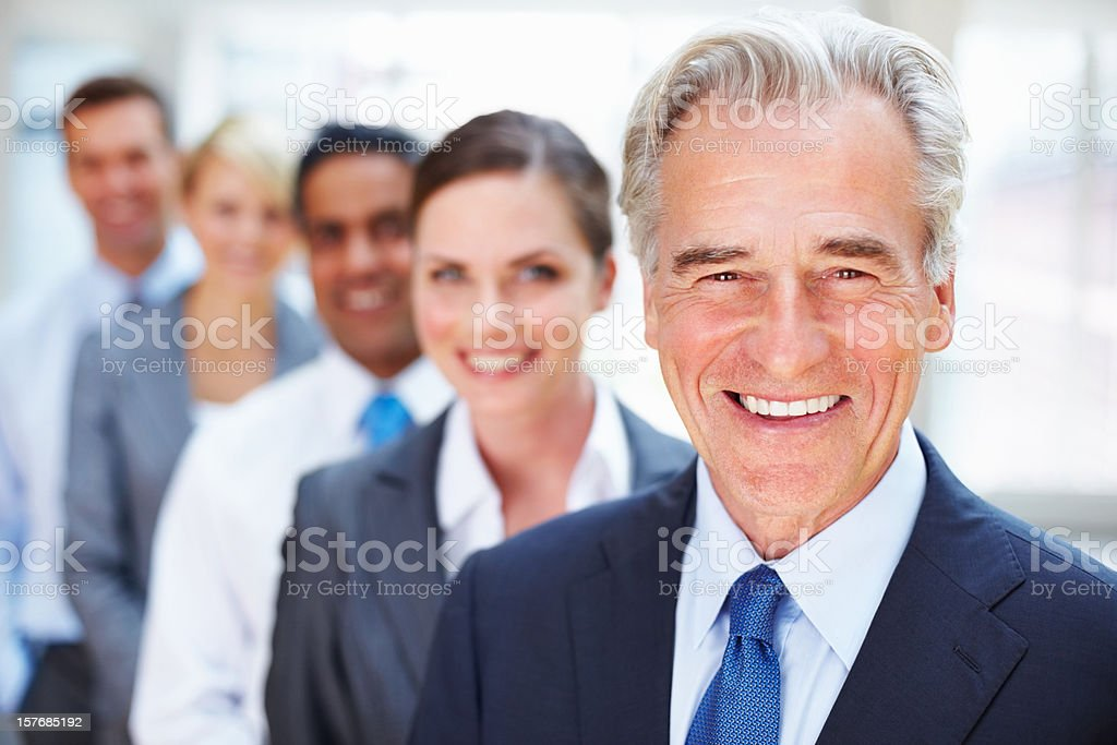 Closeup of elderly manager with business team in a row royalty-free stock photo