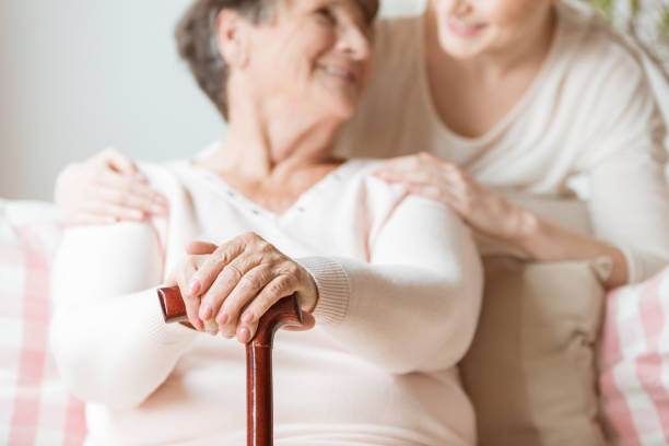 Closeup of elderly woman holding walking stick in the nursing house picture id1002521882?b=1&k=6&m=1002521882&s=612x612&w=0&h=ujzhde8 biiwpgt8wzgdgoa2ikefbmvqsiurhpkfxa0=