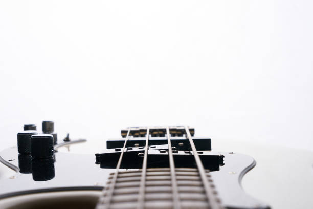 Close-up of electric classical bass guitar isolated white on background. stock photo