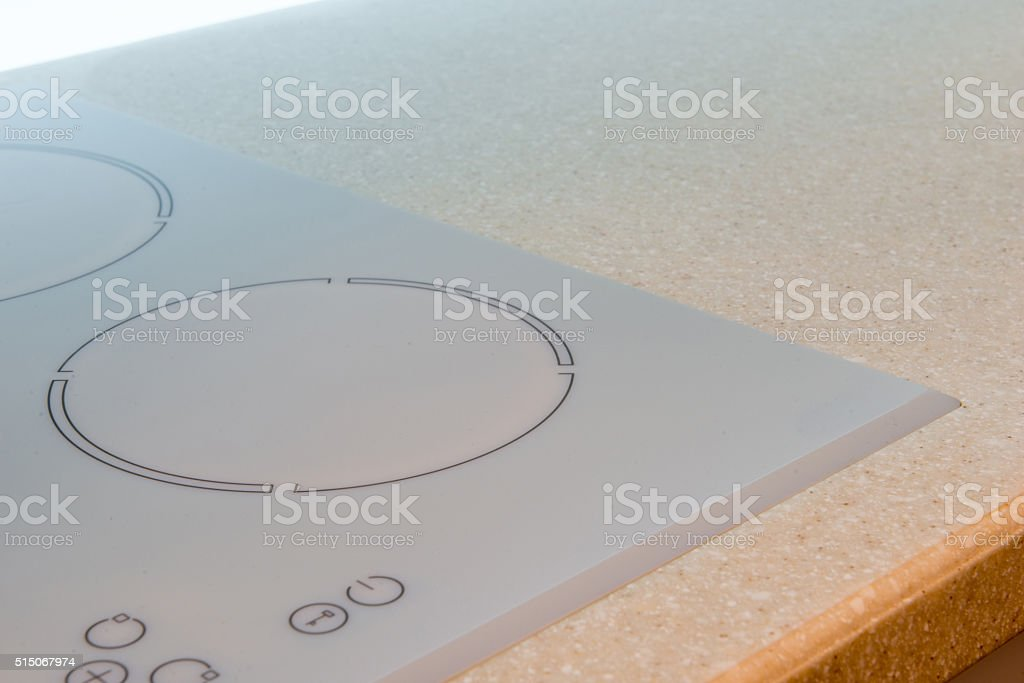 Closeup of electrical kitchen induction ceramic hob stock photo