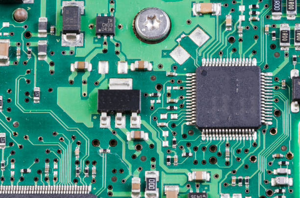 closeup of electronic circuit board with processor - mother board stock photos and pictures