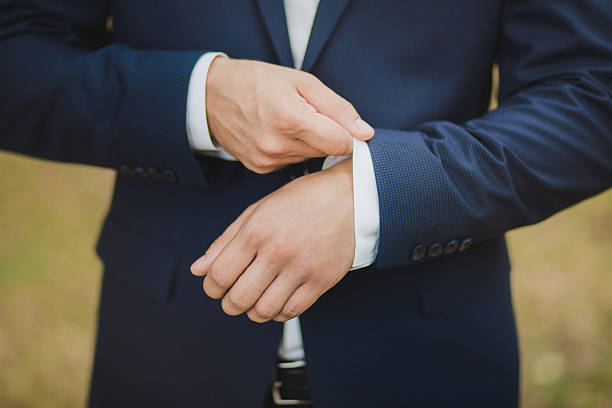 Close-up of elegance male hands wearing modern suit – Foto