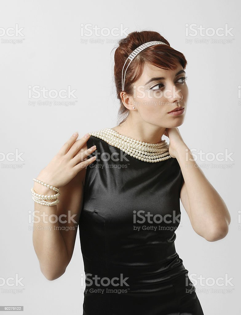 Close-up of elegant woman smartening up stock photo