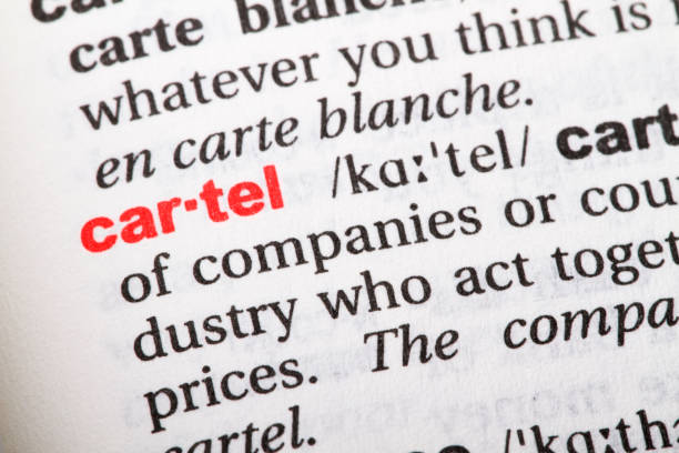 Closeup of English dictionary page with word CARTEL. Closeup of English dictionary page with word CARTEL. drug cartel stock pictures, royalty-free photos & images