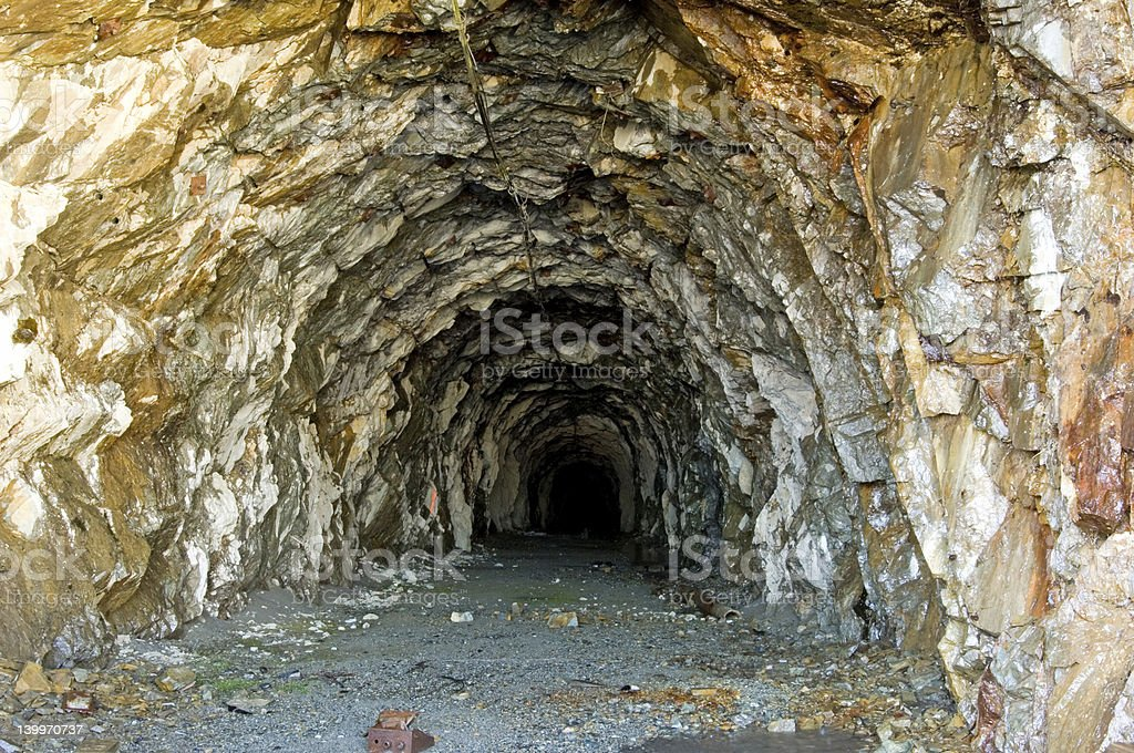 Close-up of entrance of rough old mine stock photo