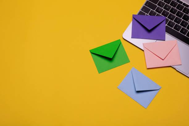 Close-up of envelopes on laptop stock photo