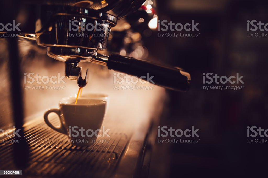 Close-up of espresso machine brewing a cup of coffee stock photo