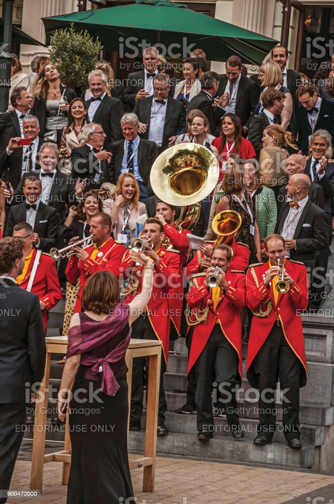 Close-up of excited musical band playing in festivity with cloudy sky at Amsterdam. stock photo