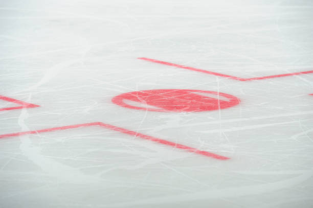 Closeup of face-off circle markings in the ice hockey rink. stock photo