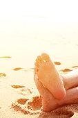 Close-up of Feet Lying on Beach Sunbathing