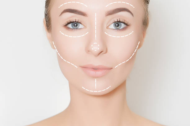 Closeup of female adult with  marks on skin for cosmetic medical procedures Face,surgery marks,anti ageing therapy,blepharoplasty,face,woman. symmetry stock pictures, royalty-free photos & images