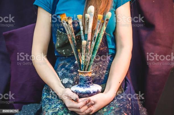 Closeup of female artist hands with paintbrushes picture id898696250?b=1&k=6&m=898696250&s=612x612&h=2cf3oxlyyuqau3j7wtvfhkhd948lpjgsgzhinzdfl8q=