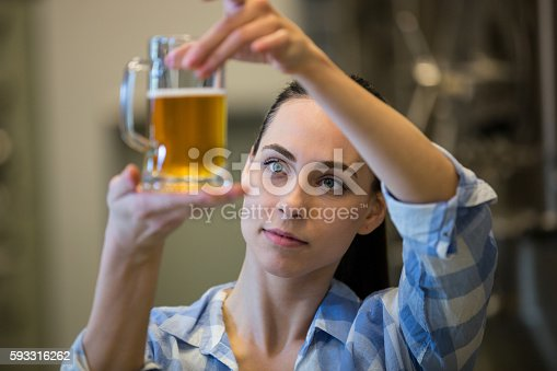 istock Close-up of female brewer testing beer 593316262