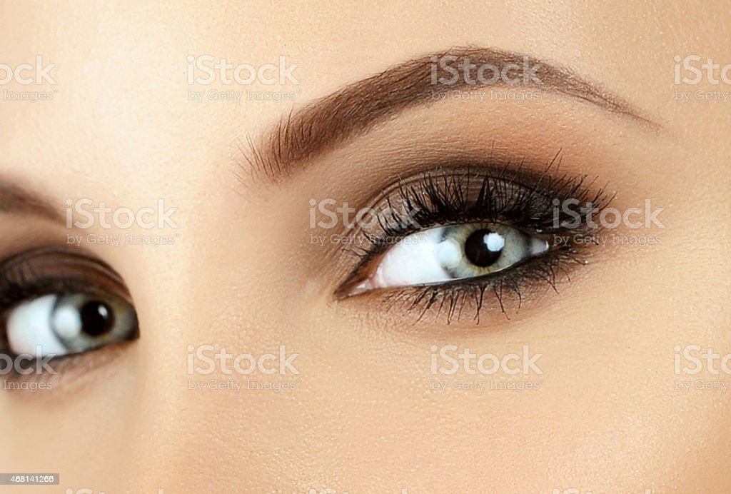 Close-up of female eyes with brown eye shadow stock photo