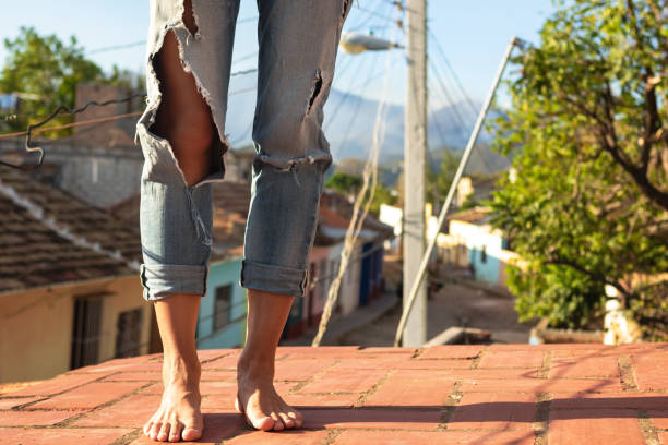 Close-up of female feets on the roof stock photo