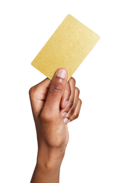 Closeup of female hand holding plastic card stock photo