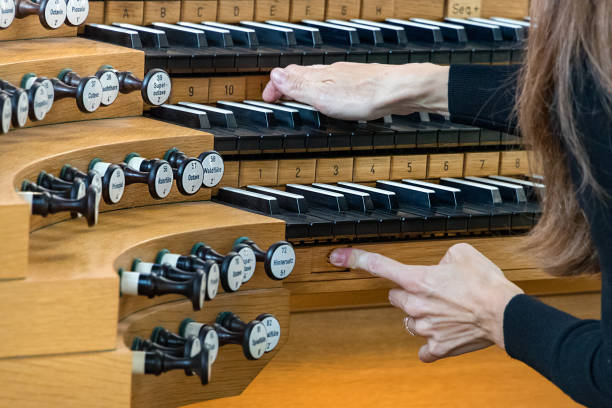 Close-up of female hands playing a Pipe Organ. stock photo