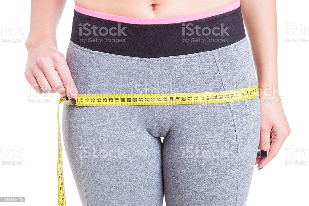 Close-up of female measuring booty line stock photo