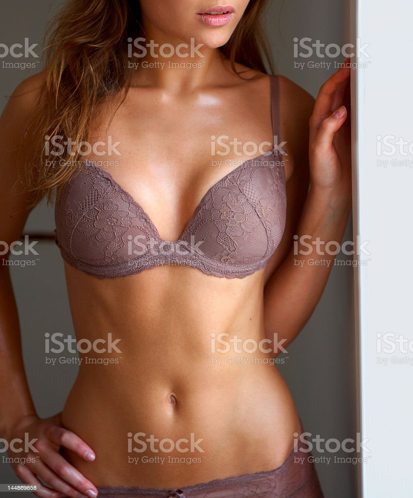 Close-up of female model posing in lingerie stock photo